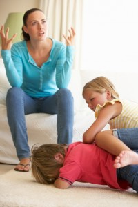 Children Fighting In Front Of Mother At Home